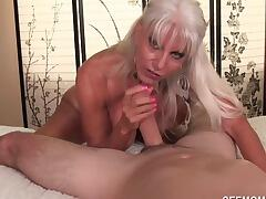 Naught granny Sally D`Angleo is horny as fuck and decide to blowjob her granddaughters new bf for fun. She lightly seduces the young boy with her massive rack and sensual voice. The poor guy has no choice but to pull out his throbbing cock for her to suck on.